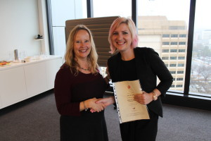 YWCA Canberra's Executive Director Frances Crimmins presents Keah Woodgate with her graduation certificate.