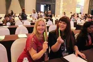 Frances Crimmins, Executive Director and Louise Billman, Manager of Early Childhood Services, show off the cool peace sign pens gifted to World Council delegates from YWCA Taiwan.