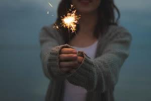 Girl holding sparkler