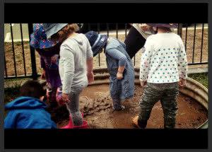 Children playing in mud at Winyu