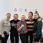 Queer emcee with female students at She Leads College Conference