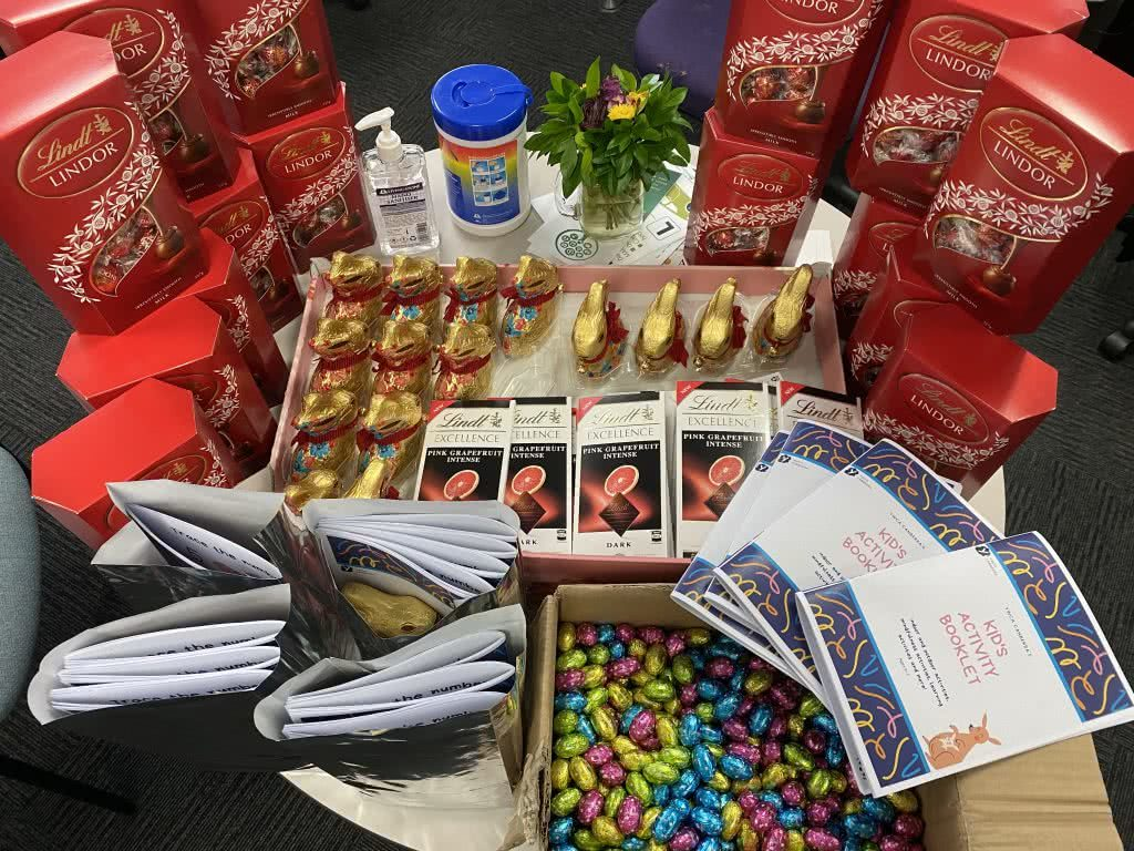 Boxes of chocolates and YWCA Canberra activity books for children.