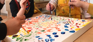 a picture of kids painting
