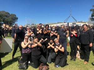 march4justice group photo of women wearing black and protesting